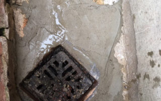 Drain repair sand/cement mix. Below renewed air brick to stop rat entry into wall cavity.